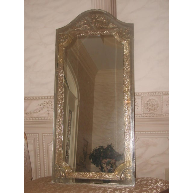 Unusual 20th century large foil mirror has tones of silver and gold in the 2 inch wide foil banding with ornate designs...
