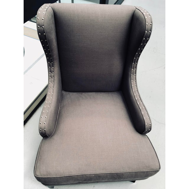 LA floor sample. Bel Air wing chair with nailhead Discontinued fabric and the name is unknown. Color is charcoal