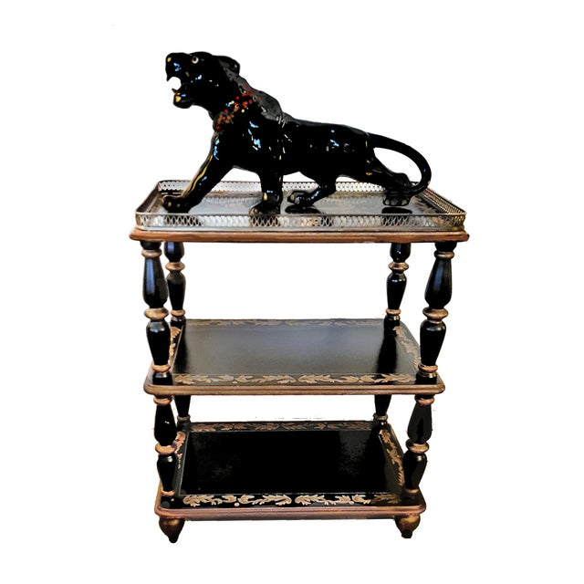 For sale is a vintage reproduction of a Victorian era ebonized wooden shelving unit that rests upon gilded bun feet. The...