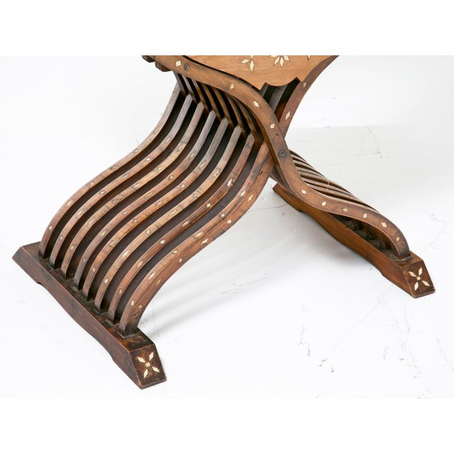 The Savonarola chair originated in Italy in the renaissance and spread throughout Europe. This fine pair of inlaid...