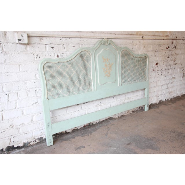 Offering a very nice vintage French Provincial king-size headboard by John Widdicomb. The headboard has nice French and...