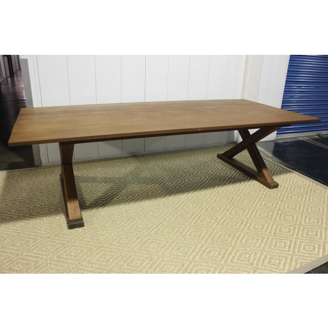 "Beautifully made X base dining table. Custom made in Los Angeles. We recommend to have the table re-stained. 108""L x 48""D..."