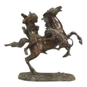 Continental (19th Cent) bronze of Nubian figure on a rearing horse holding a cub and being attacked by a tiger
