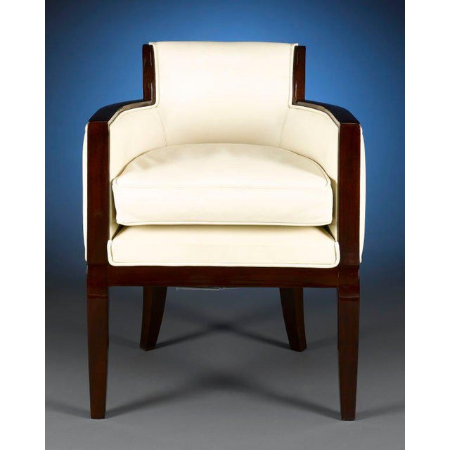 Sleek and sophisticated, this outstanding Art Deco armchair is crafted with modern elegance in mind. White leather...