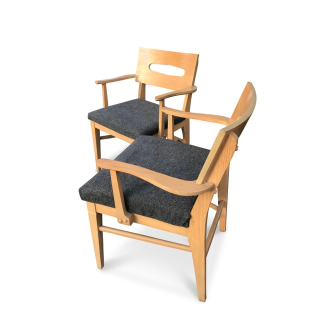 A pair of elegant mid-Century modern chairs, perfect as occasional chairs, side chairs or dining chairs or they could also...