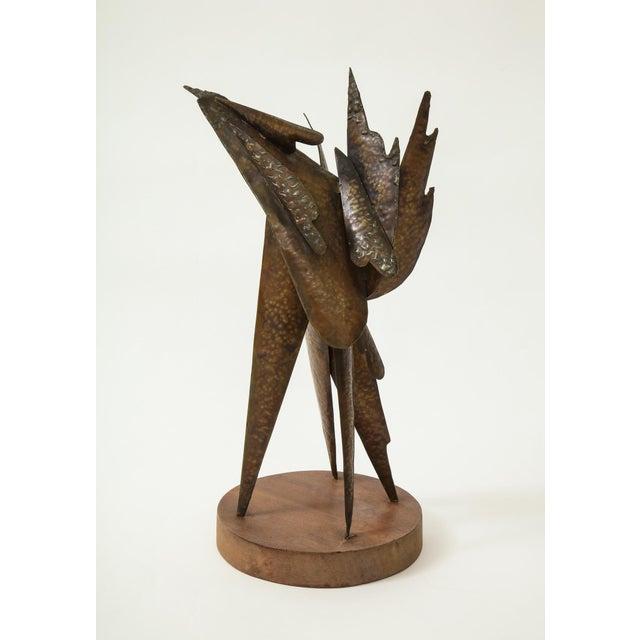 Brutalist sculpture of cut, fused, and assembled metal on wooden base by New England artist Homer Gunn (1919-2001). Gunn...
