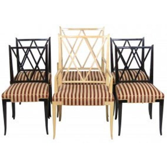 A fine set of chairs. X back chairs with two large king and queen arm. Unique set. Designed by Tommi Parzinger for Charak...