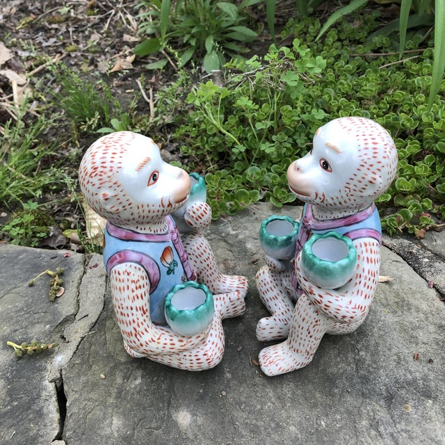 Pair of vintage Chinoiserie monkey candle holder figurines. These would make a great accent to any decor with or without...