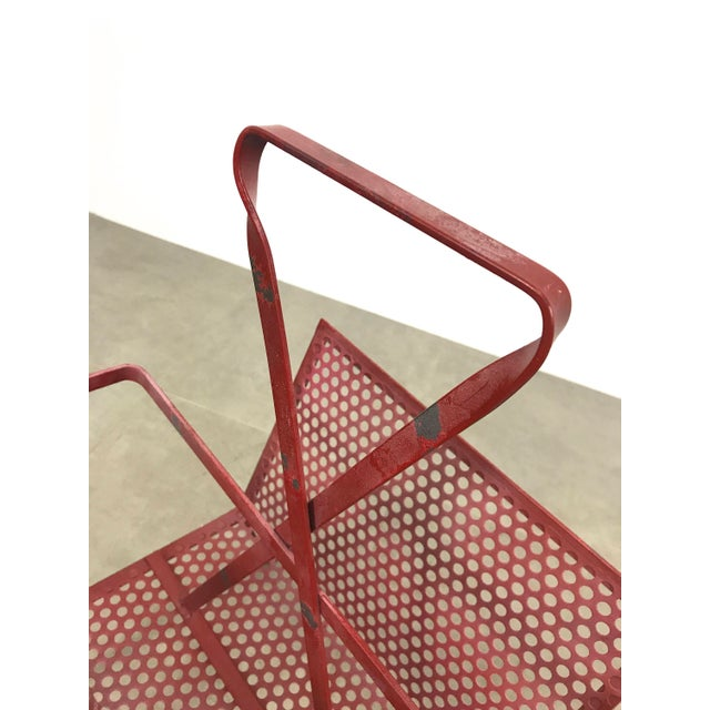 Vintage magazine holder attributed to Mathieu Matégot, 1950's. Perforated metal on S-frame for compartmentalized storage,...