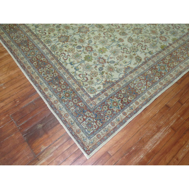 An early 20th Century room size Rug with an all-over design on a ivory. Professionally Cleaned and able to endure heavy...