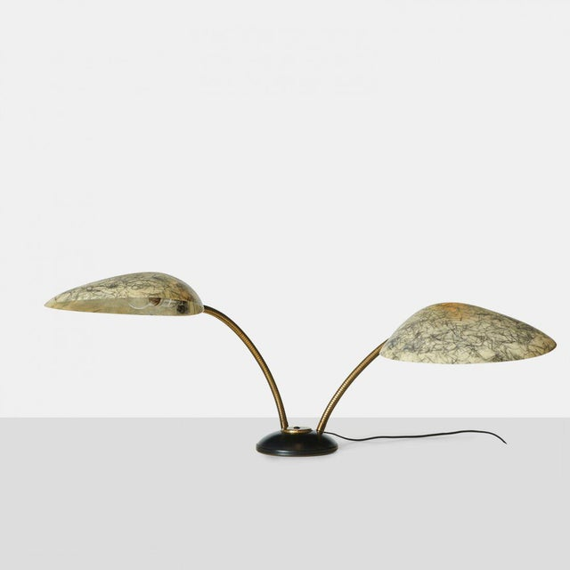 This Cobra table lamp features coarse fiberglass shades which are mounted on brass gooseneck arms and a lacquered iron...