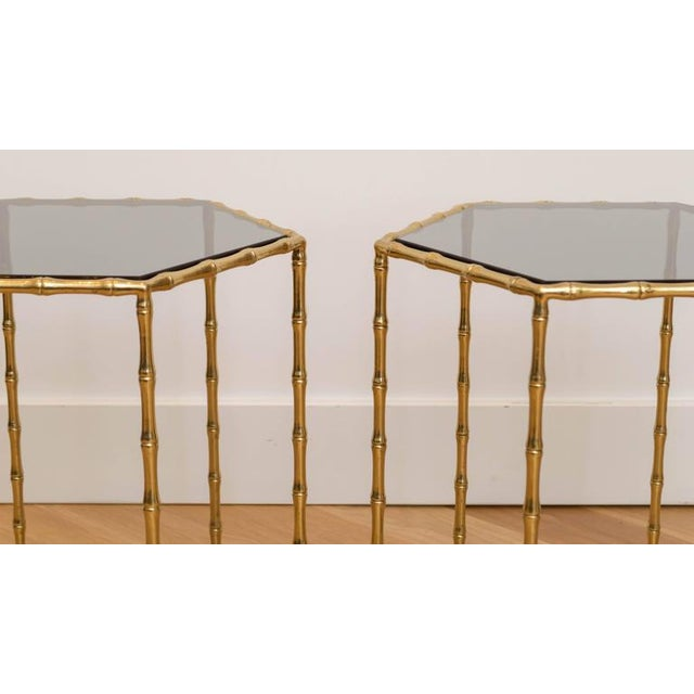 Handsome pair of brass faux bamboo tables with new smoked glass tops.