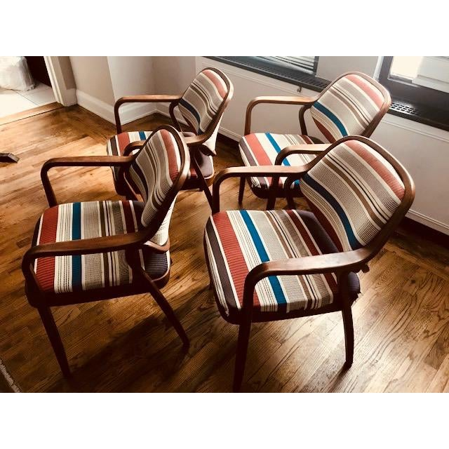 Classic set of 1970's bentwood 1105 Knoll chairs by Don Pettit. Two lengths of pressed and bent layers of sculpted...