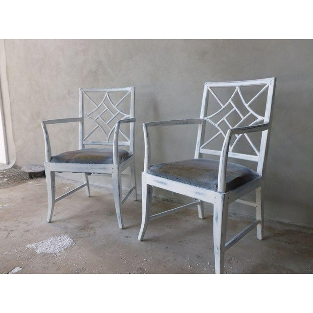 This is a pair of fabulous modern Chinese Chippendale armchairs in the style of McGuire. Superb construction pegged at the...
