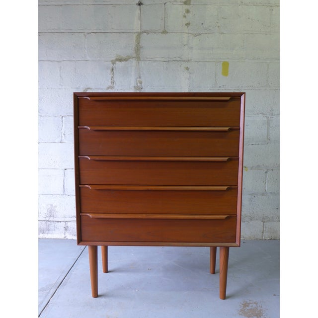 Exceptional mid century Modern Teak dresser with five spacious drawers. Sculpted drawer pulls and long tapered legs. The...