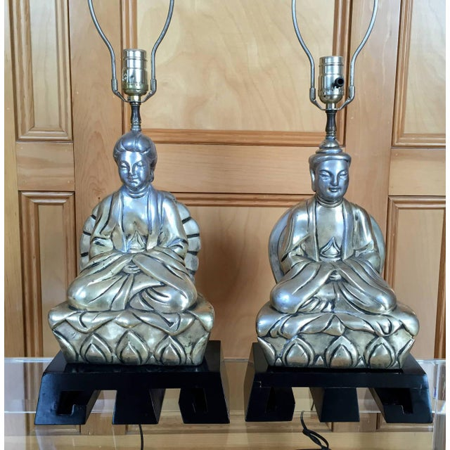 These 1950s stylized lamps of a Chinese man and woman wearing ceremonial robes, are in the style of the great James Mont....