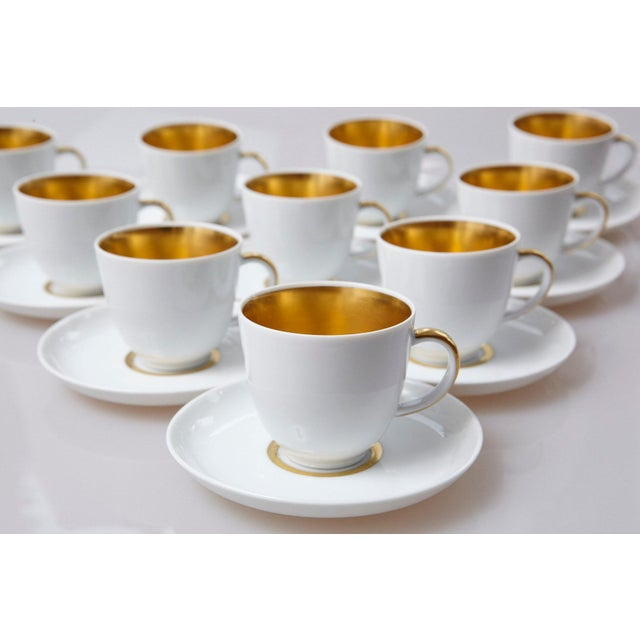 Beautiful set of ten white and 22-karat gold porcelain demitasse or mocca / espresso cups and saucers, with gold interior,...