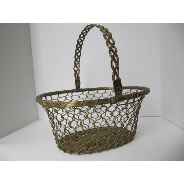 """Beautiful brass woven basket with collapsable handle. Measures with the handle down 11.75""""L x 5""""H with handle up measures..."""