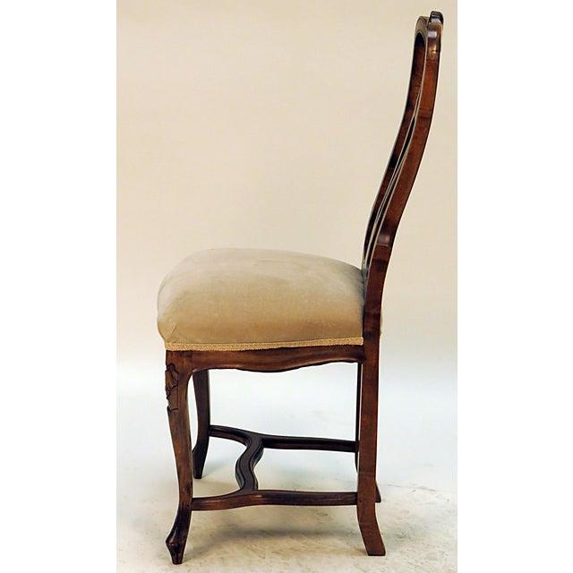 Elegant carved French upholstered side chair.