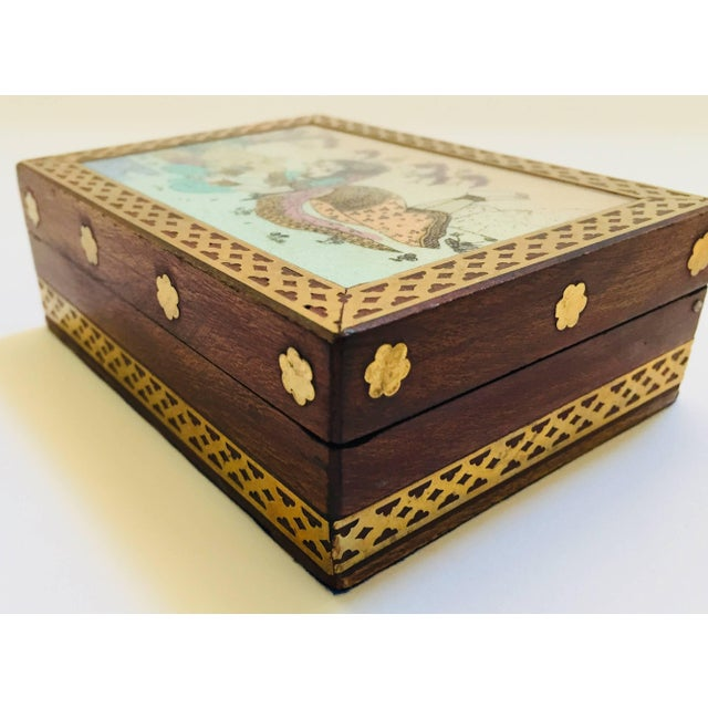Anglo-Indian wooden box decorated with brass and hand-painted with a scene of a young lady in a forest with traditional...
