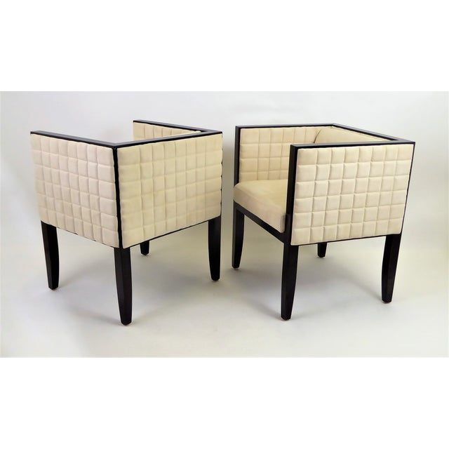 """Sleek pair of Pietro Constantini """"Yale"""" armchairs. In quilted ultrasuede and black lacquered wood with movable shaped back..."""