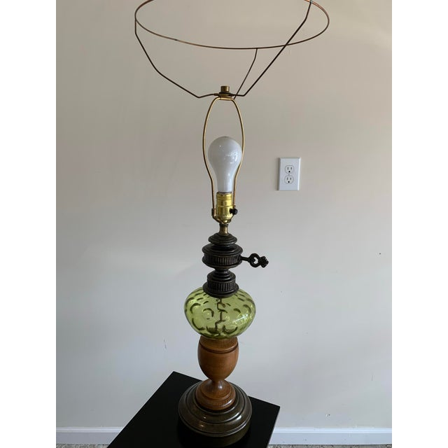 American Vintage Hepplewhite Carved Wood Urn, Cast Metal, and Green Depression Glass Lamp With Burlap Shade For Sale - Image 3 of 7