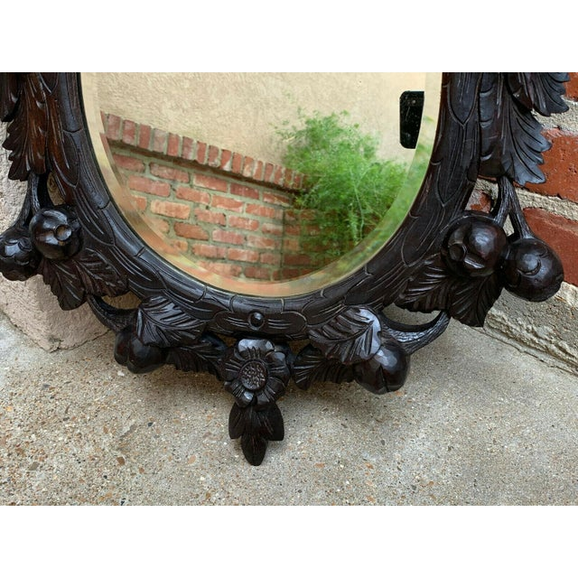 Ebony 19th Century Antique English Black Forest Style Carved Dark Oak Oval Wall Mirror For Sale - Image 8 of 13