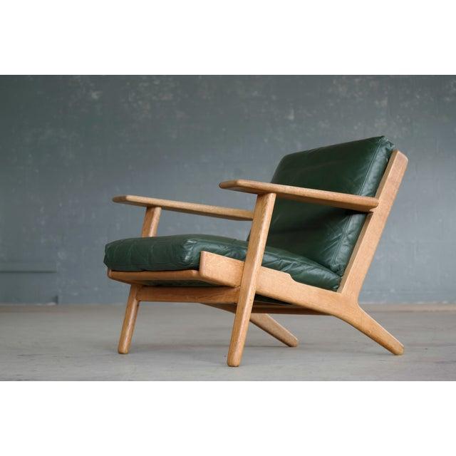 Mid-Century Modern Hans Wegner Highback Lounge Chair Model GE290 for Getama Oak and Green Leather For Sale - Image 3 of 11