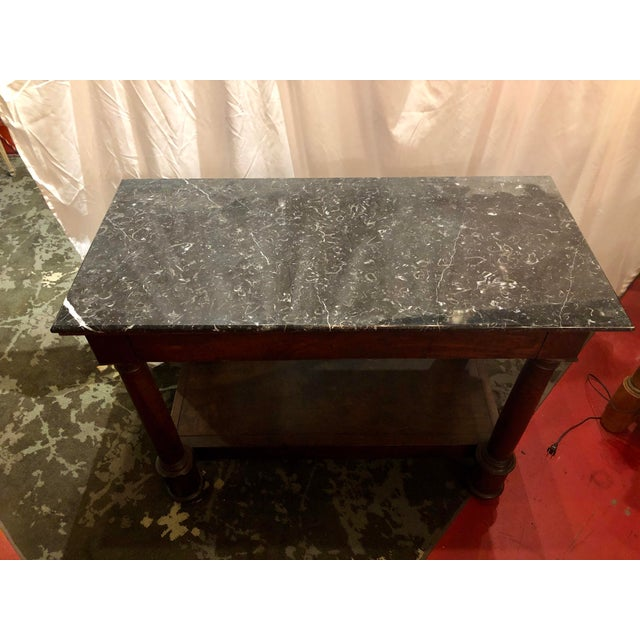 """Beautiful French Empire period console dressed with Pyrenees marble. In the French vernacular its """"Dans son jus"""" which..."""