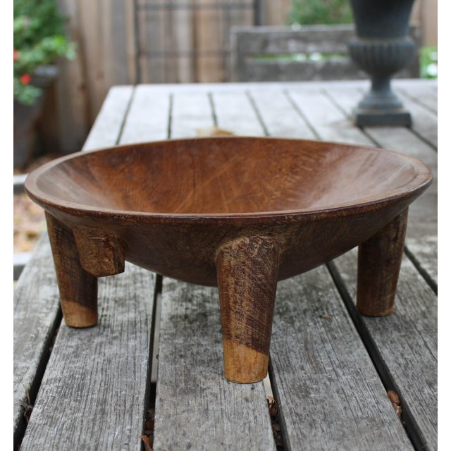 This stunning vintage Fiji Kava bowl is carved in the form of a stylized turtle. The rounded wooden dish stands raised on...