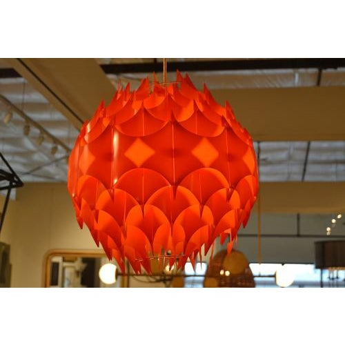 Fabulous vintage pendant from France, c.1970s. Very unique fixture made of thin plastic shapes fitted and held together by...