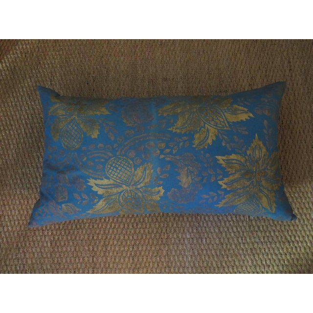 Extravagant pillow featuring hand-dyed linen that has been created using illustrated wooden blocks, which in turn have...