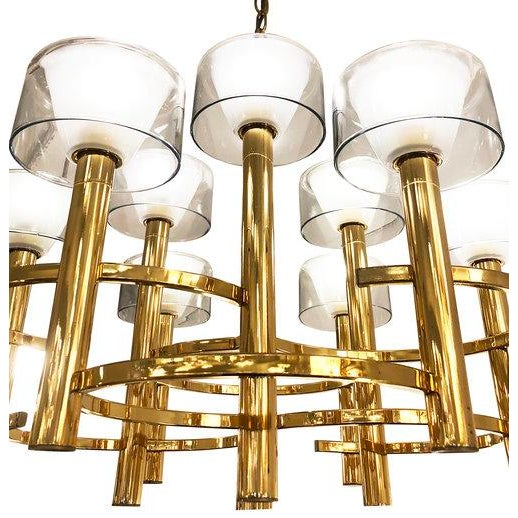 Rare Gaetano Sciolari ceiling light with a brass frame composed of overlapping circles holding nine cylinders with glass...