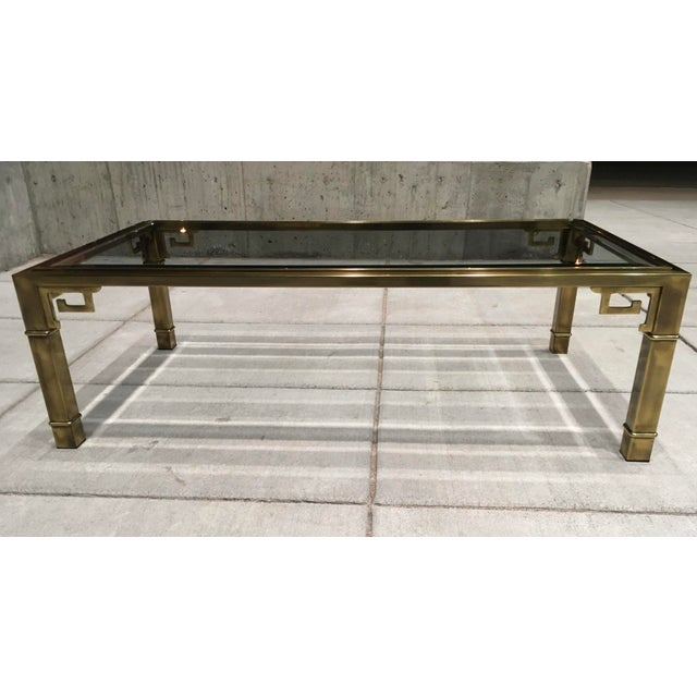 Large rectangular shaped aged brass and glass Greek key coffee or cocktail table manufactured in Grand Rapids, MI by...
