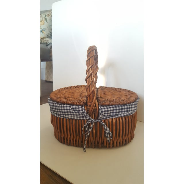 Large woven wicker picnic basket, featuring a cloth blue and white checkered interior Perfect to take to the beach, lake,...
