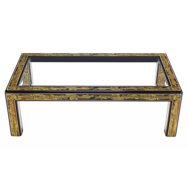 Coffee table by Mastercraft with Bernhard Rohne acid etched brass panels on all sides, leaving only the bull-nose black...
