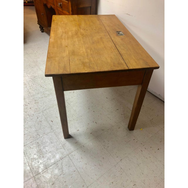 Antique and very sturdy table / desk in pine with two drawers and a inkwell in the back center. The table is in great...