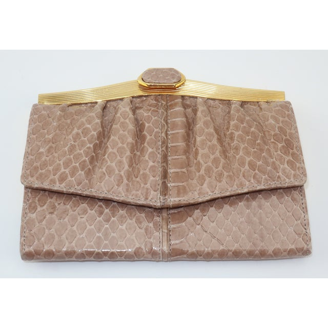 Lovely Judith Leiber tri-fold wallet in a neutral taupe snakeskin with coordinating leather interior and jewelry quality...