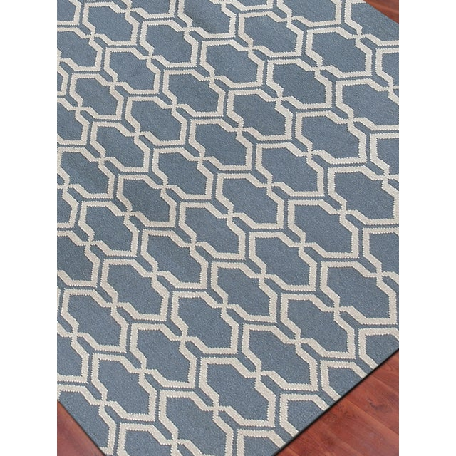 This whimsical flat-woven rug is hand-crafted in fun colors and updated patterns that make it perfect for a kids room or...