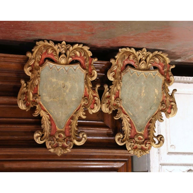 Decorate a study or library with this colorful pair of antique shields. Crafted in Italy circa 1920, each traditional...