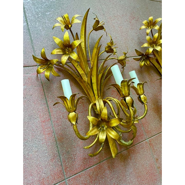 Pair of Gilt Toleware Italian Mid Century Hollywood Regency Floral Motif Electric Three Light Wall Sconces. Newer wiring...