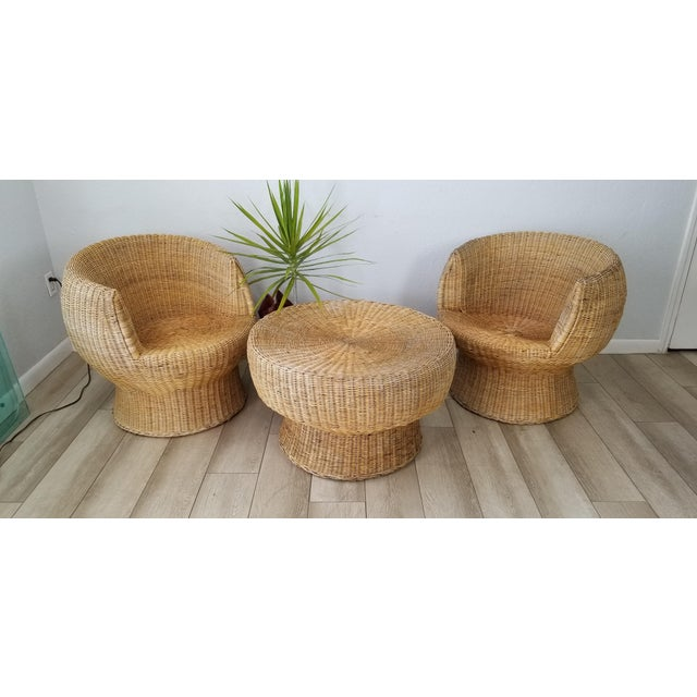 We are very please to offer for sale this Stunning sculptural pair of woven wicker pod chairs and Coffee Table set of...