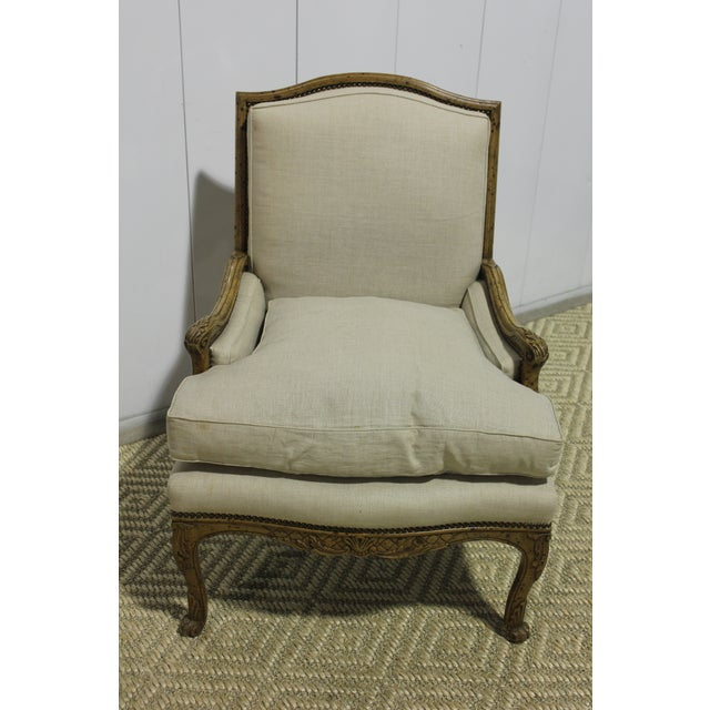 Yale R. Burge Arm Chair, upholstered in linen with nail trim details, painted finish. Perfect as a side chair, accent or...