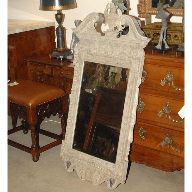 This is a George III Style painted mirror. This 20th century piece is in good vintage condition. Region: England...
