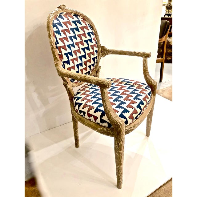 This is a great set of 6 circa 1980s carved faux bois arm chairs that are in excellent condition and have been recently...
