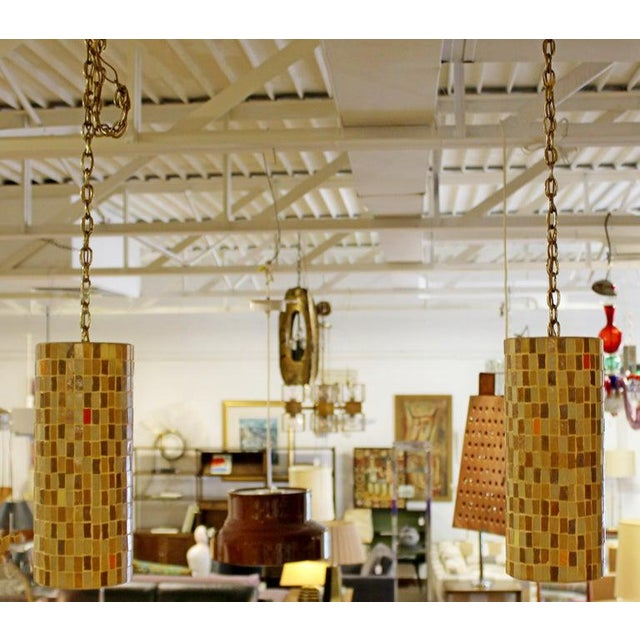 For your consideration is a stunning pair of Italian, Murano glass tile, hanging light fixtures, circa the 1960s. In...