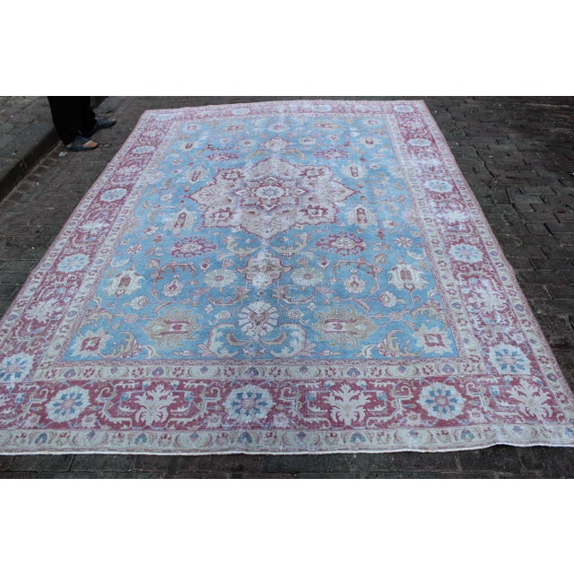 Vintage Tabriz Turkish rug in vibrant rasperry and sky blue with wheat detail. Rug has been shaved and hand distressed to...