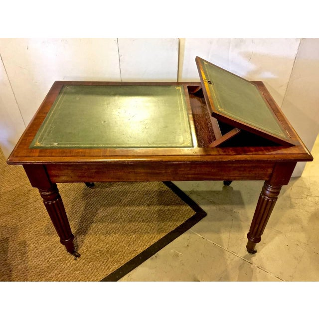 This is an uncommon form of period William IV (circa 1830-1835) desk or writing table that incorporates a book stand at...