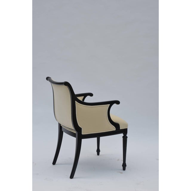 """Pair of chic black lacquer and cream velvet neoclassical armchairs. By William """"Billy"""" Haines. Provenance: Tom May estate...."""