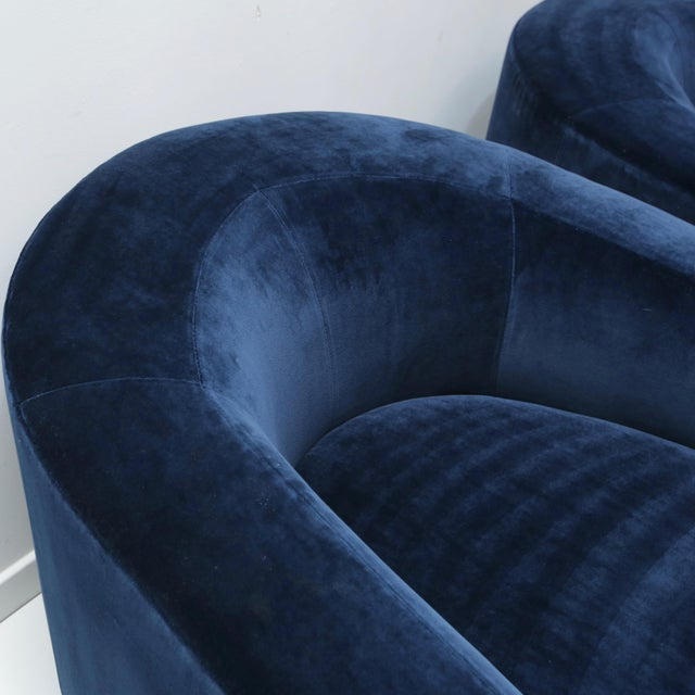 Super comfy tub chairs covered in deep navy blue Kravet cotton velvet. Chairs are modeled after the Donghia volume tub chair.
